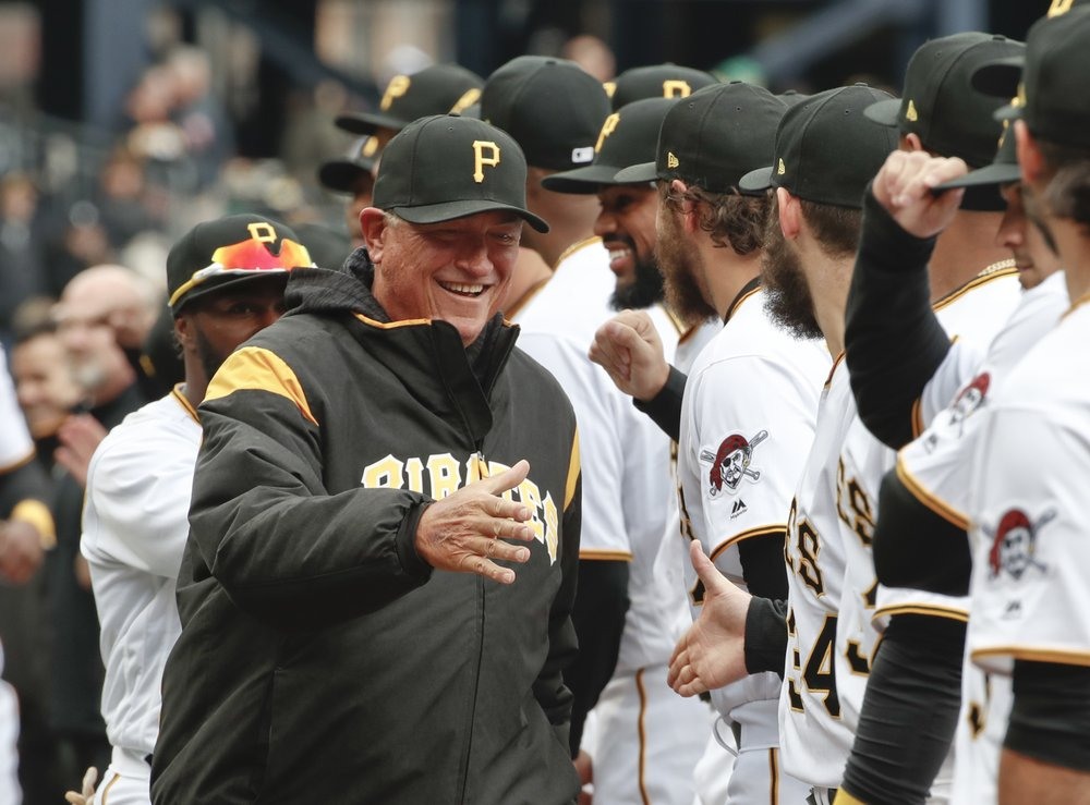 Pittsburgh Pirates' Clint Hurdle (left) greets players as he introduced before the Pirates' home opener baseball game against the Minnesota Twins in Pittsburgh. (AP Photo/Gene J Puskar, File)