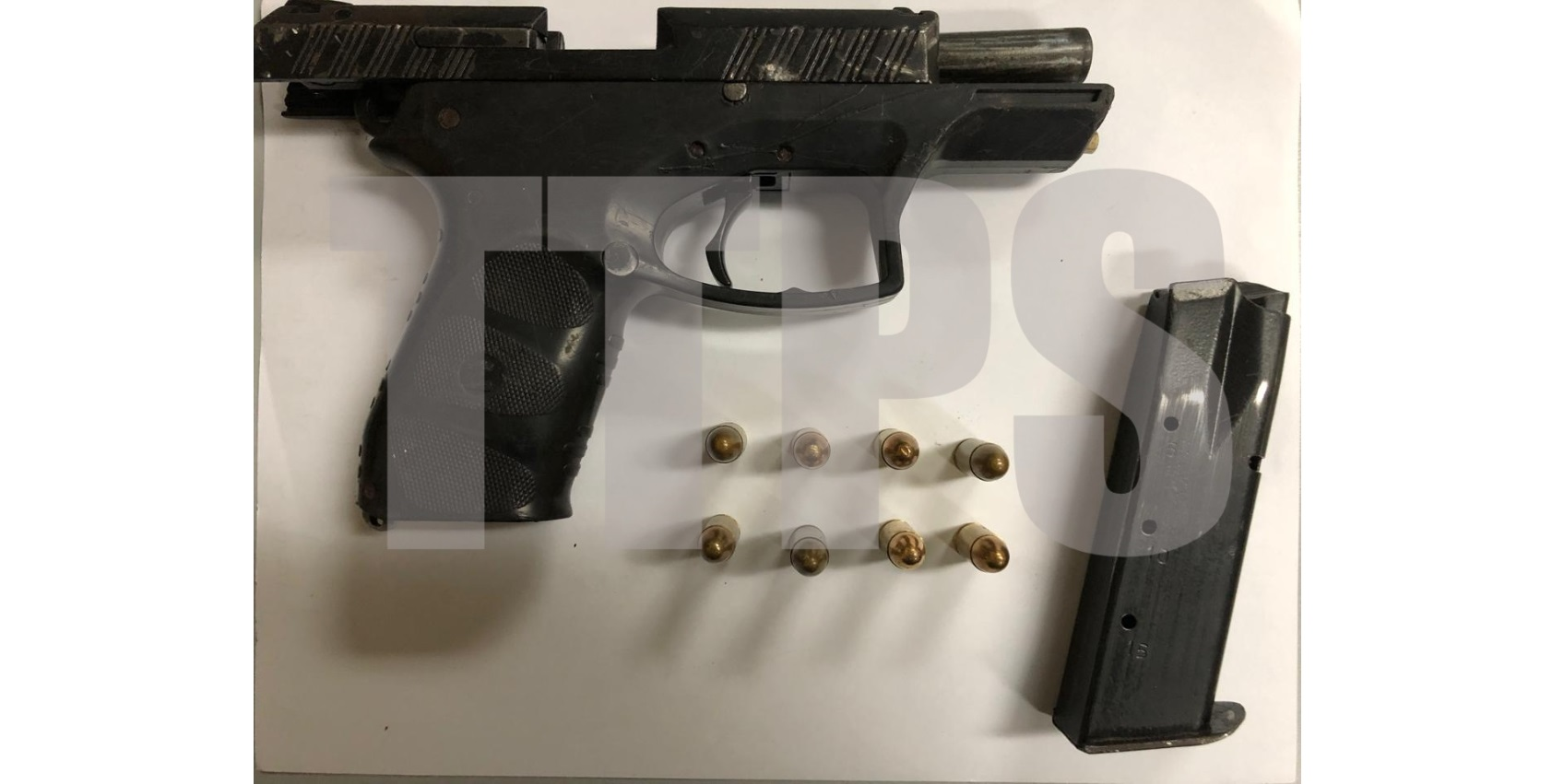 Seized: A pistol an ammunition which were found in a plastic bag in Cocorite.