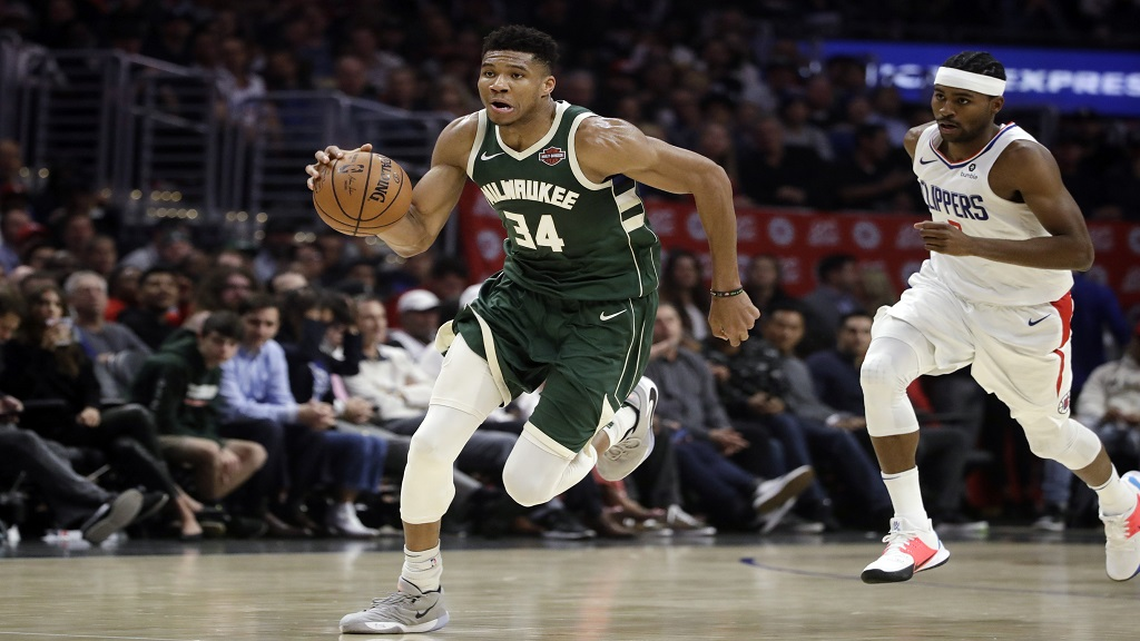 Milwaukee Bucks' Giannis Antetokounmpo (34) dribbles past Los Angeles Clippers' Maurice Harkless during the second half of an NBA basketball game Wednesday, Nov. 6, 2019, in Los Angeles. (AP Photo/Marcio Jose Sanchez).