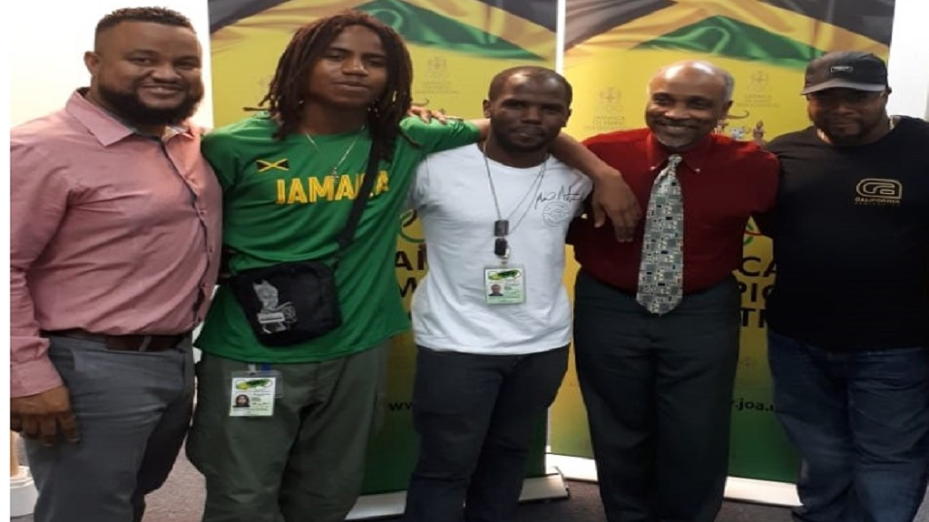 (From left) Ryan Foster, President of Skateboarding Jamaica Limited (SJL), Tafari Whitter (national skateboarder), Mario Notice (national skateboarder), Christopher Samuda, Jamaica Olympic Association (JOA) President and Steve Douglas, Vice-President, SJL, pose during a courtesy call at the JOA headquarters.