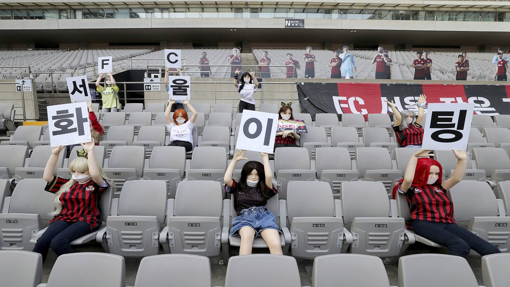 In this May 17, 2020 photo, Cheering mannequins are installed at the empty spectators' seats before the start of football match between FC Seoul and Gwangju FC at the Seoul World Cup Stadium in Seoul, South Korea. (Ryu Young-suk/Yonhap via AP).