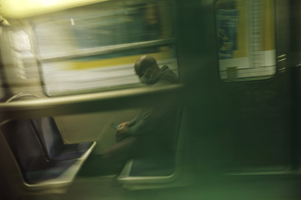 A man wears a face mask to protect against the spread of the new coronavirus as he sits on a Metro train, in Paris. France continues to be under an extended stay-at-home order until May 11 in an attempt to slow the spread of the COVID-19 pandemic. (AP Photo/Thibault Camus)