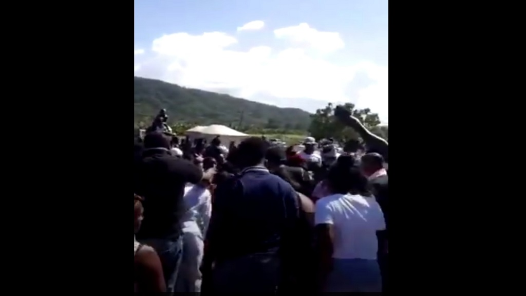 A screengrab from a viral video of a burial that was held in Annotto Bay, where social distancing was clearly not being practised.