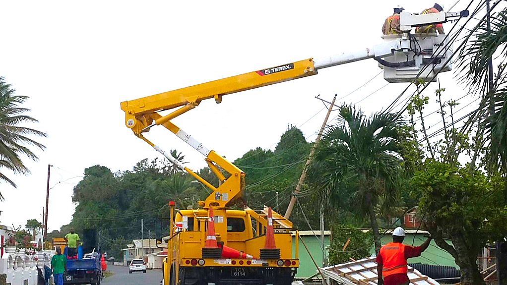 File photo. T&TEC workers conduct repairs on an electricity pole.