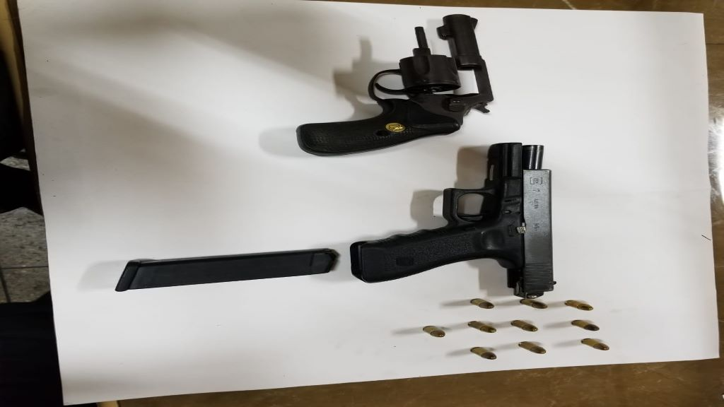 Pictured: A Glock 9mm pistol as well as a Smith and Wesson .38mm revolver were seized during a police operation by officers of the Northern Division on May 15, 2020.