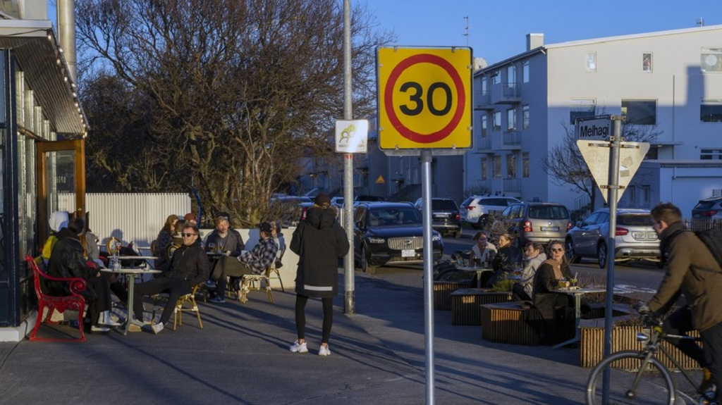 In this photo taken on Wednesday, April 29, 2020, people gather at a restaurant in Reykjavik after the country recorded days of zero new cases of COVID-19. By identifying infected people even when they had no symptoms, the tiny North Atlantic nation managed to identify and isolate cases where many bigger countries have struggled. (AP Photo/Egill Bjarnason)