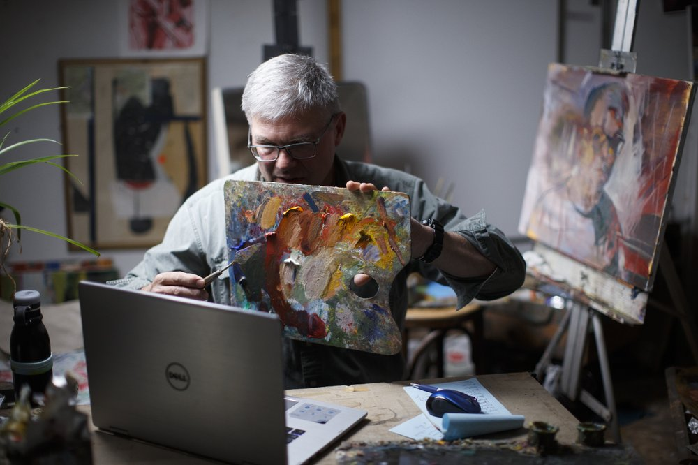 Fred Haag shows how to mix colors during his Art 50: Introduction to Painting course from a loft studio at his small farm in Hellam, Pennsylvania. (AP Photo/Matt Slocum)
