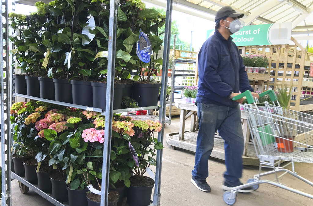 A customer shops in a garden and DIY centre, as the country is in lockdown to help stop the spread of coronavirus, Tuesday, May 12, 2020. The government has announced that as of Wednesday May 13 garden centres will be opening but operating with new measures such as social distancing. (AP Photo/Kirsty Wigglesworth)
