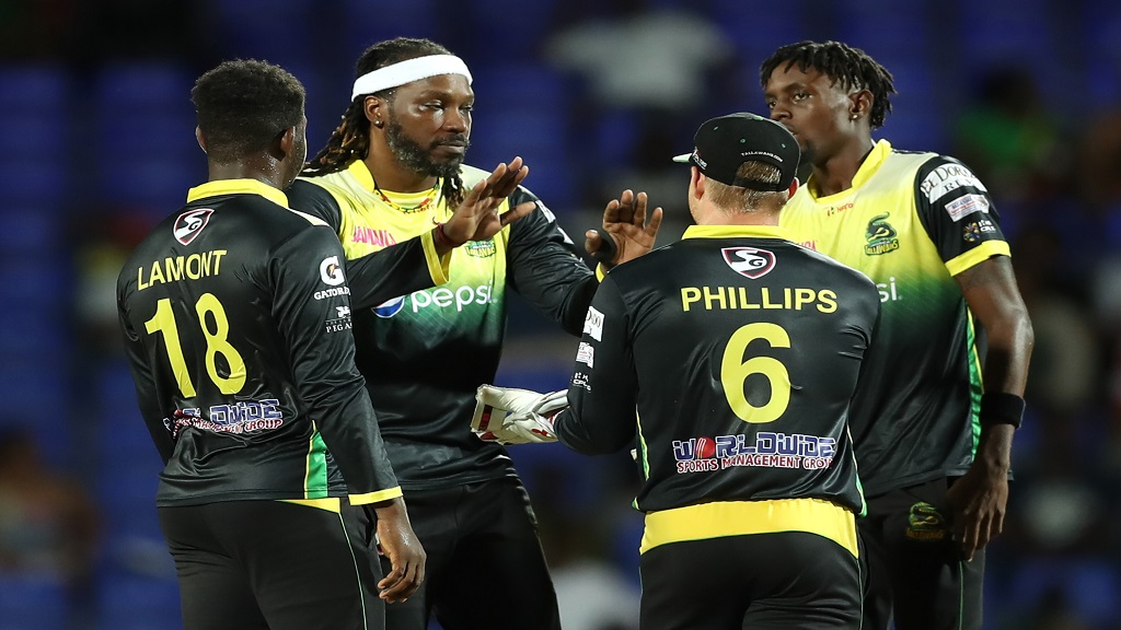 Chris Gayle (2nd left) celebrates with his Jamaica Tallawahs teammates during last year's Caribbean Premier League.