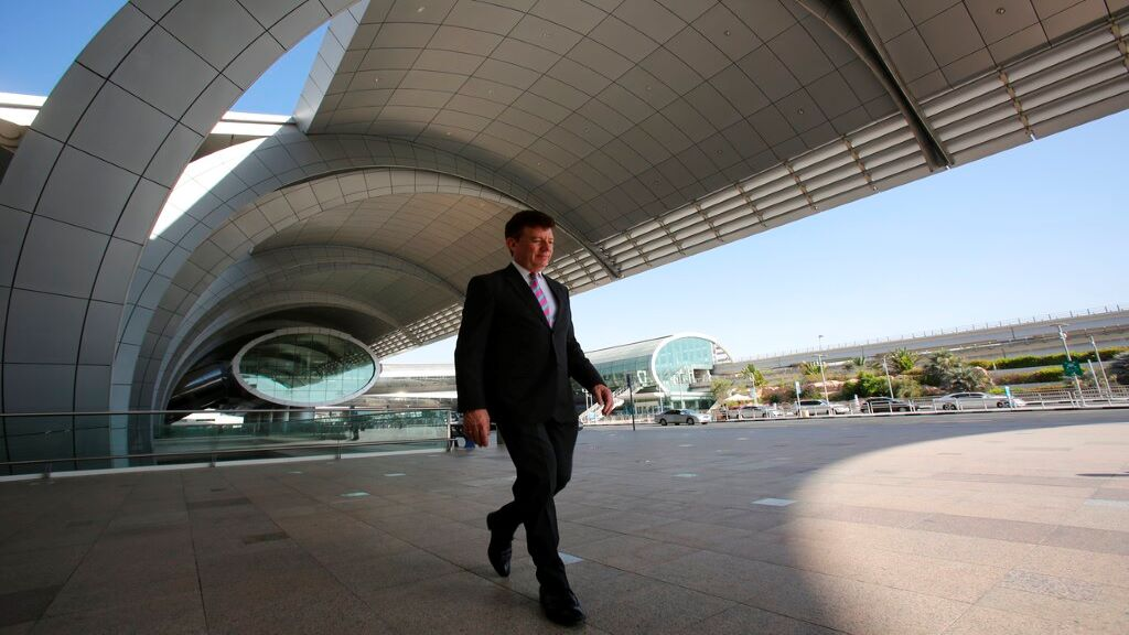 FILE - In this June 17, 2014, file photo, Dubai Airports CEO Paul Griffiths walks out of Dubai International Airport's Terminal 3 in Dubai, United Arab Emirates. (AP Photo/Kamran Jebreili, File)