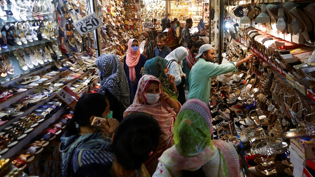 People visit a market after the government relaxed the weeks-long lockdown that was enforced to curb the spread of the coronavirus, in Lahore, Pakistan, Monday, May 11, 2020. (AP Photo/K.M. Chaudhry)