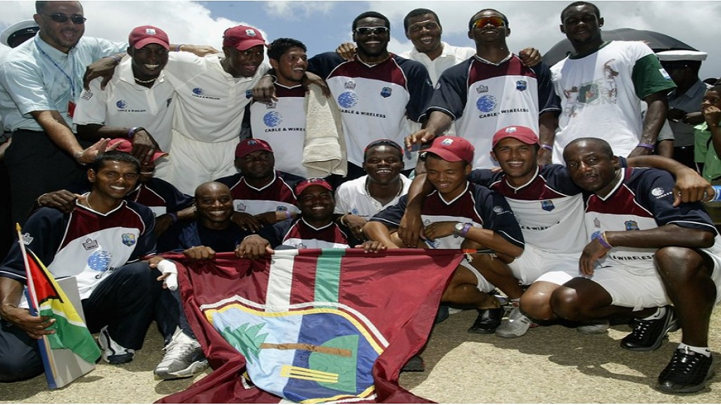 West Indies players celebrate following a world record for the highest run chase in Test history against Australia at the Antigua Recreational Ground in 2003.