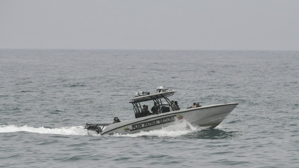 Security forces patrol near the shore in the port city of La Guaira, Venezuela, Sunday, May 3, 2020. Interior Minister Nestor Reverol said on state television that security forces overcame before dawn Sunday an armed maritime incursion with speedboats from neighbouring Colombia in which several attackers were killed and others detained. (AP Photo/Matias Delacroix)