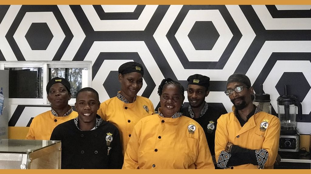 Members of the Premier Kitchen team (front row, from left) Khadia Omealy, Jean Carter-Brown, Ijah Nunes, and (back row, from left) Sharon Stewart, Jodian McIntosh, executive sous chef, and Kadeem McIntosh.