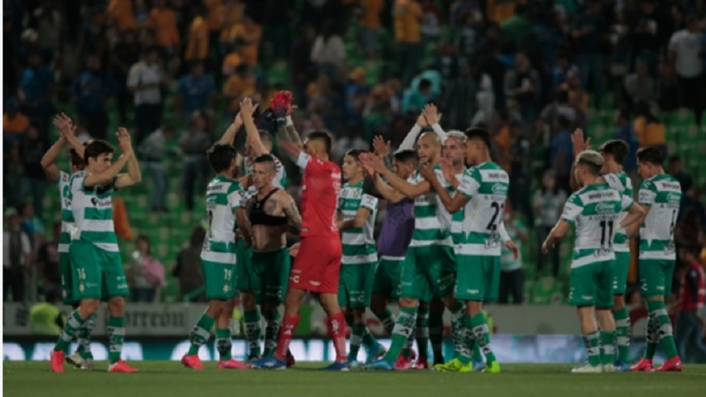 Santos Laguna celebrate a victory in February.