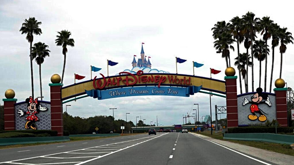 The road to the entrance of Walt Disney World has few cars Monday, March 16, 2020, in Lake Buena Vista, Florida. (AP Photo/John Raoux)