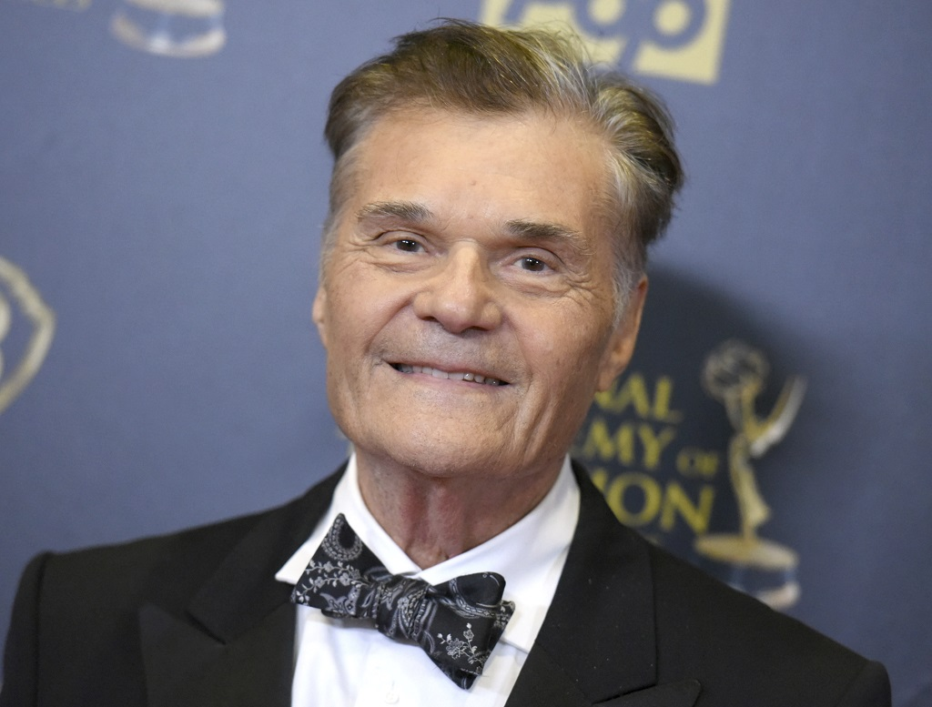 "FILE - In this April 26, 2015, file photo, Fred Willard poses in the pressroom at the 42nd annual Daytime Emmy Awards at Warner Bros. Studios in Burbank, Calif. Willard, the comedic actor whose improv style kept him relevant for more than 50 years in films like ""This Is Spinal Tap,"" ""Best In Show"" and ""Anchorman,"" has died at age 86. Willard's daughter, Hope Mulbarger, said in a statement Saturday, May 16, 2020, that her father died peacefully Friday night. (Photo by Richard Shotwell/Invision/AP, File)"