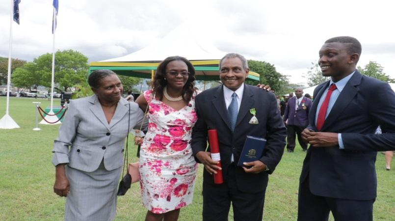 Late photojournalist Michael Gordon (second right) with his family after being conferred with a national honour in 2016.