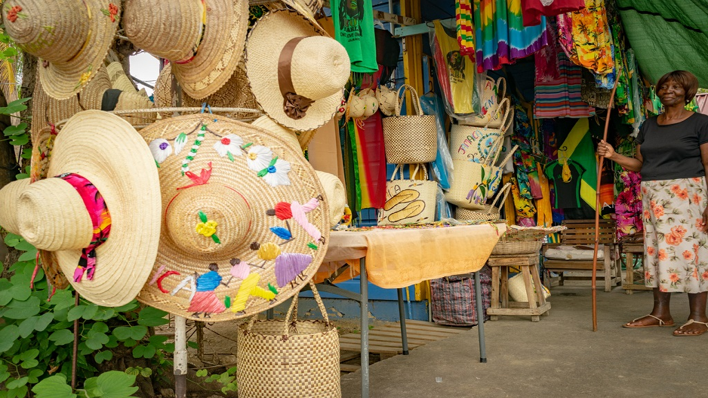 iStock photo of a female vendor with woven handbags, beach hats, and other clothing merchandise in Jamaica. Craft vendors registered with the TPDCo are eligible for a one-time grant of $40,000 under the government's COVID-19 relief programme.