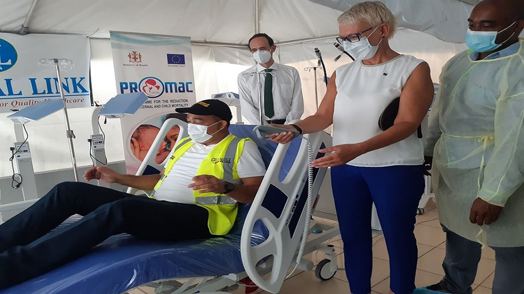 Health Minister Dr Christopher Tufton (seated) tests one of the recently donated medical equipment. Sharing in the moment is EU Ambassador to Jamaica Malgorzata Wasilewska (second right) along with other stakeholders.