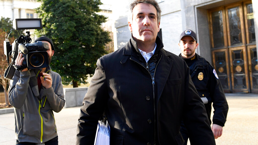 In this Feb. 21, 2019, photo Michael Cohen, President Donald Trump's former personal attorney, leaves Capitol Hill in Washington. (AP Photo/Susan Walsh)
