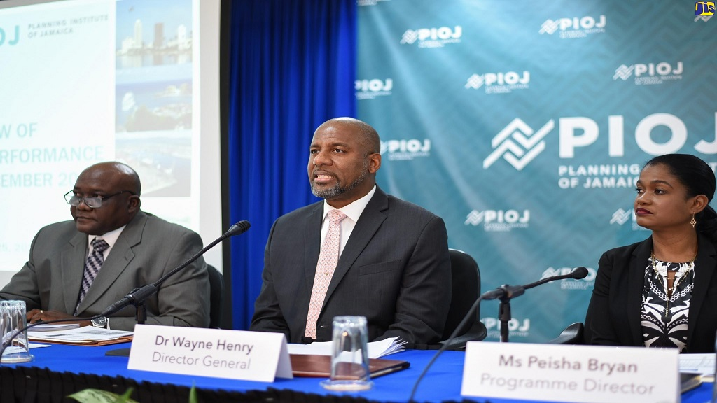 Planning Institute of Jamaica (PIOJ) Director General, Dr Wayne Henry (centre), speaks at a recent media briefing. Listening (from left) are Senior Director for the PIOJ's Economic Planning, Research and Policy Logistics Division, James Stewart, and Programme Director for the Vision 2030 Jamaica Secretariat at the PIOJ, Peisha Bryan.