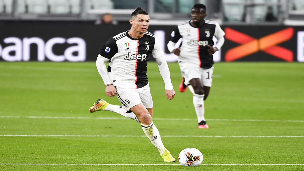 In this March 8, 2020 file photo, Juventus' Cristiano Ronaldo runs with the ball during the last Serie A football match Juventus played before the coronavirus stop, at the Allianz Stadium in Turin, Italy.  (Marco Alpozzi/LaPresse via AP).