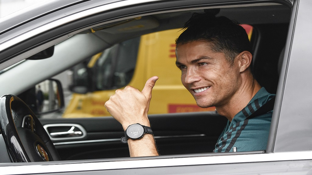 Cristiano Ronaldo leaves the Juventus sport center after his first training, in Turin, Italy, May 19, 2020.  (Fabio Ferrari/LaPresse via AP).