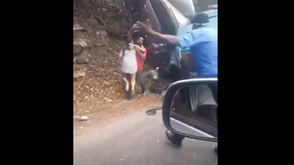 A screen grab from a video of a woman being taken from the dramatic wreckage of a motorcar that recently collided with a large truck in the Bog Walk Gorge in St Catherine.