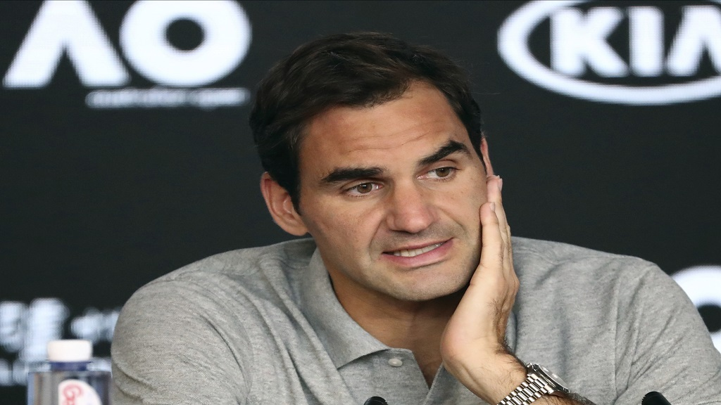 In this Jan. 30, 2020, file photo, Switzerland's Roger Federer speaks during a press conference following his semifinal loss to Serbia's Novak Djokovic at the Australian Open tennis championship in Melbourne, Australia. Federer leads the annual Forbes ranking of highest-paid athletes with what the magazine says is $106.3 million in total earnings. (AP Photo/Dita Alangkara, File).