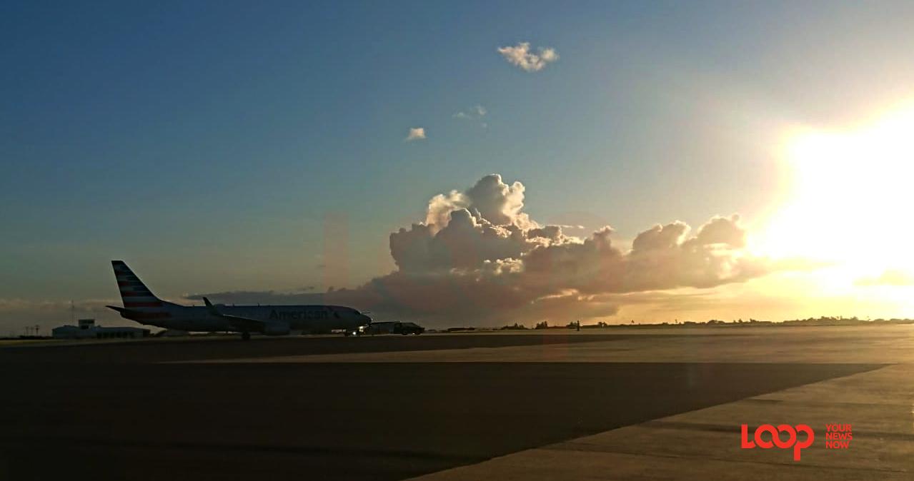 American Airlines flight at Barbados' Grantley Adams International Airport at sunset on November 15, 2020.