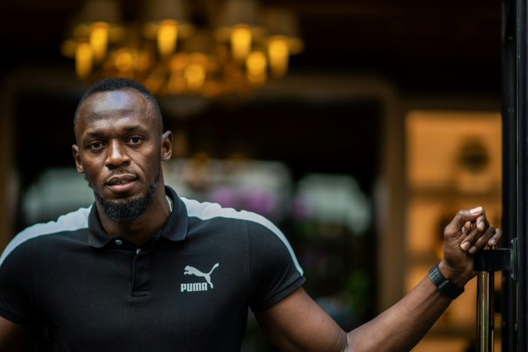 L'ancienne superstar de l'athlétisme Usain Bolt lors du lancement d'un service de trottinettes électriques à son nom à Paris le 15 mai 2019