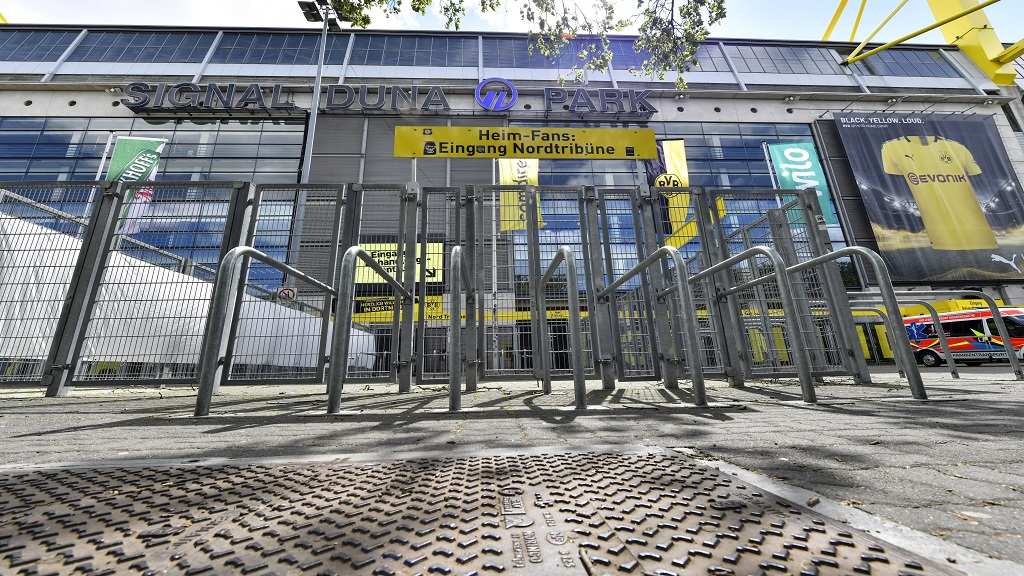The supporter's entrance of the Signal Iduna Park, Germany's biggest stadium of Borussia Dortmund, is closed in Dortmund, Germany, Thursday, May 14, 2020. Bundesliga will now restart on May 16, 2020 when Borussia Dortmund will play the derby against FC Schalke 04 at home without spectators due to the coronavirus outbreak. (AP Photo/Martin Meissner).