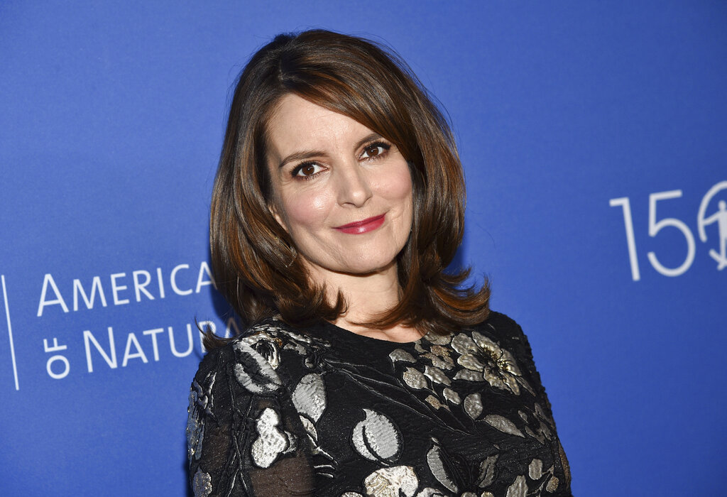 "FILE - In this November 21, 2019, file photo, actress Tina Fey attends the American Museum of Natural History's 2019 Museum Gala in New York. Fey says more than $115 million was raised toward supporting New Yorkers impacted by COVID-19 during a virtual telethon. A tearful Fey said ""Thank you, thank you"" in reaching the dollar amount as host of the Rise Up New York! event Monday, May 11, 2020. (Photo by Evan Agostini/Invision/AP, File)"