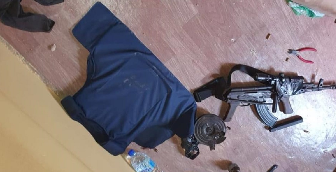 Photo: Police said an assault rifle, fitted with a scope and spin barrel, was found and seized at the scene. Photo via police sources.