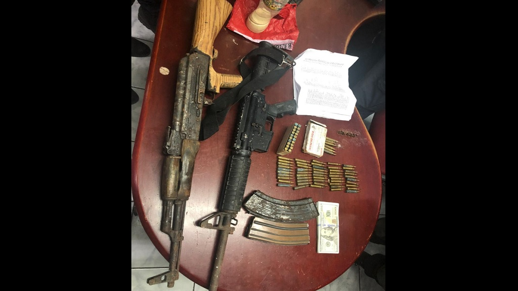 The assault rifles, ammunition and other illegal items which were seized by the security forces in Hollywood Norwood in St James on Thursday afternoon.