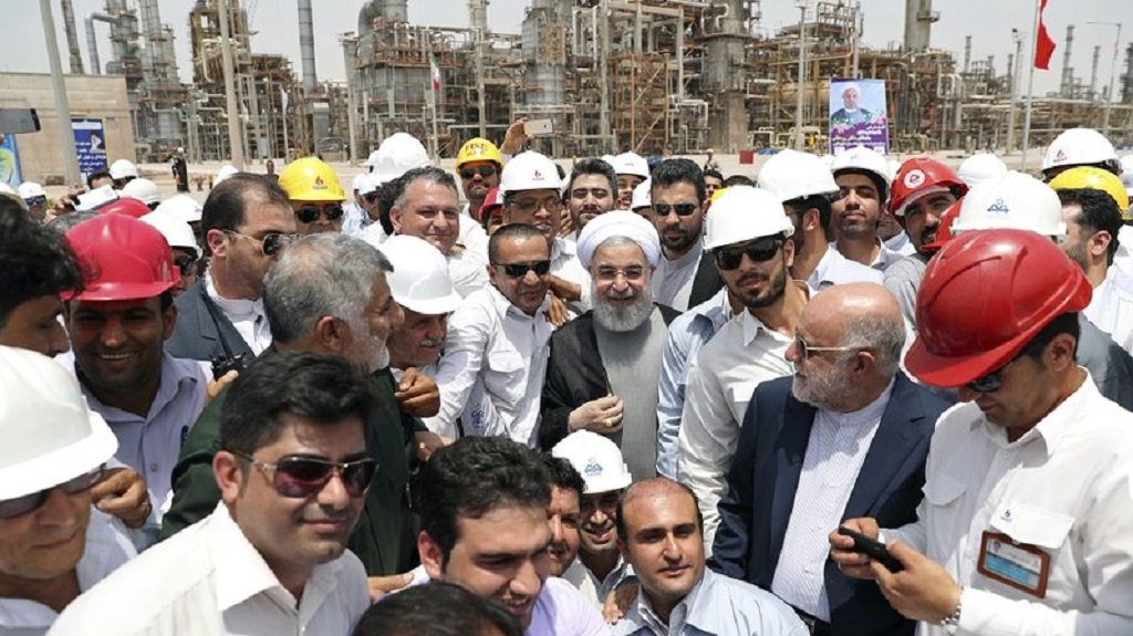 FILE - In this April 30, 2017 file photo, released by an official website of the office of the Iranian Presidency, Iranian President Hassan Rouhani, center, inaugurates the Persian Gulf Star Refinery in Bandar Abbas, Iran. (Iranian Presidency Office via AP, File)