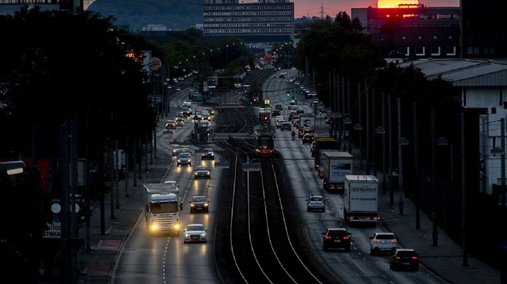 The sun rises over one of of the main roads in Frankfurt, Germany, Friday, May 15, 2020. (AP Photo/Michael Probst)