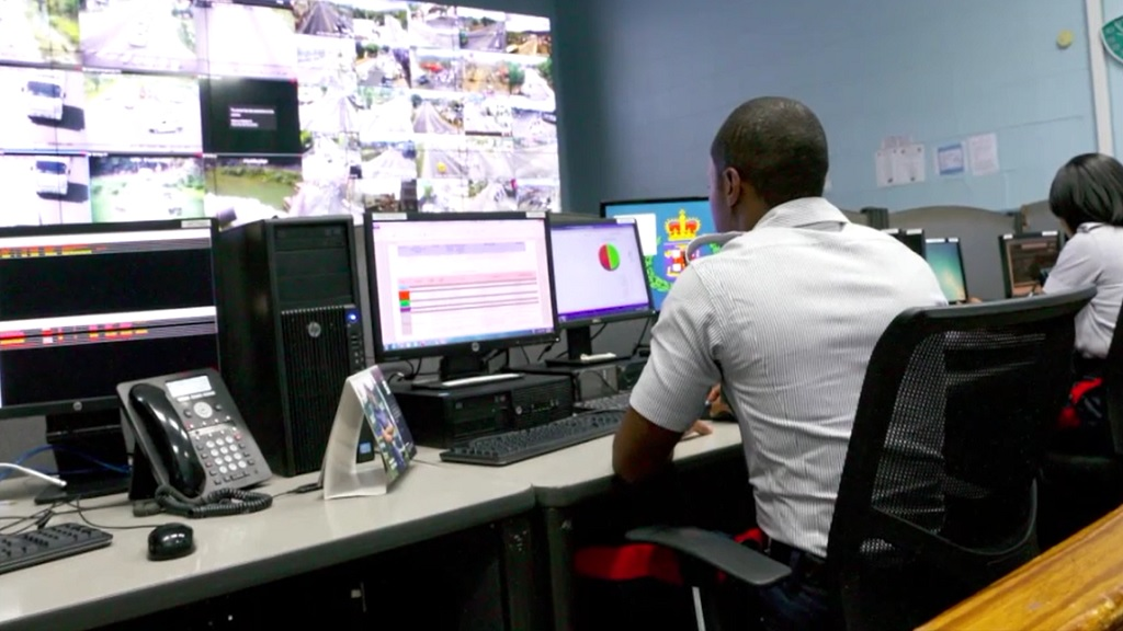 Police officers monitor CCTV cameras at the Police Emergency Control Centre.