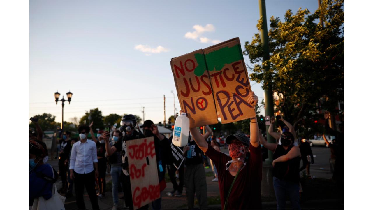 Demonstrators gather Thursday, May 28, 2020, in St. Paul, Minn. Protests over the death of George Floyd, the black man who died in police custody broke out in Minneapolis for a third straight night. (AP Photo/John Minchillo)