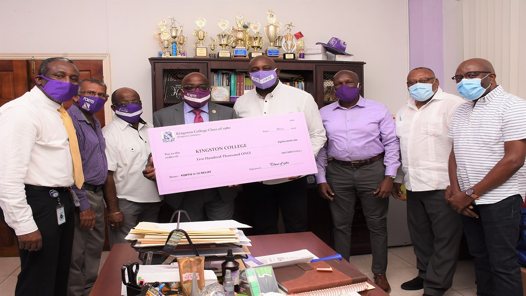 Members of the KC Class of 1980 present a symbolic cheque of $500,000 to principal, Dave Myrie, at the school on Tuesday, May 6 to assist in the Fortis Covid-19 Relief Effort. Pictured from left are Noel Greenland, Kenneth Aratram, Audley Nurse, Wayne Jones, Dave Myrie (Principal), Patrick Duncan, Michael Leslie, and Evroy Johnson.