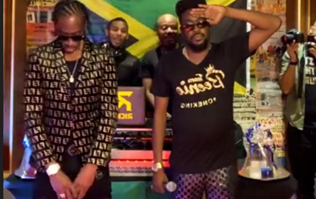 Bounty Killer (l) and Beenie Man and their designated disc jocks Richie D and Kurt Riley (centre) observe the National Anthem ahead of the Verzuz battle.