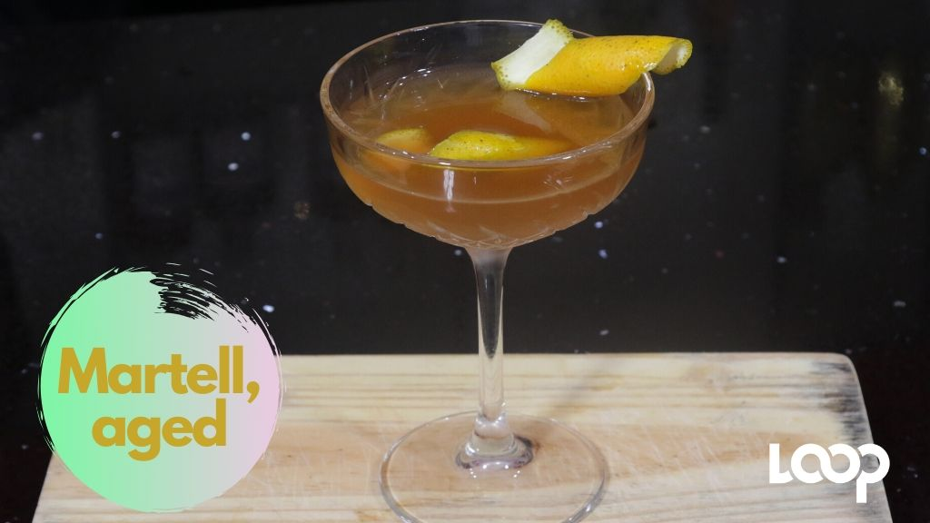 "The ambrosial Martell, ""aged"" quarantini presents subtle citrus notes."