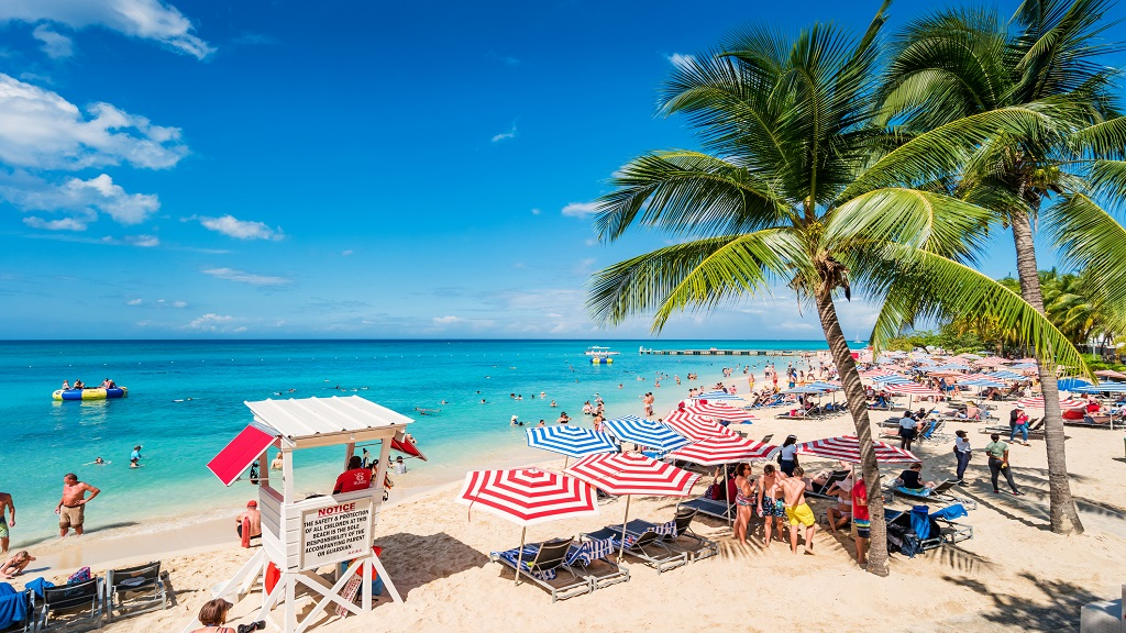 People enjoy Doctor's Cave Beach, a famous, white, sandy beach in Montego Bay Jamaica on a sunny day. (iStock photo)