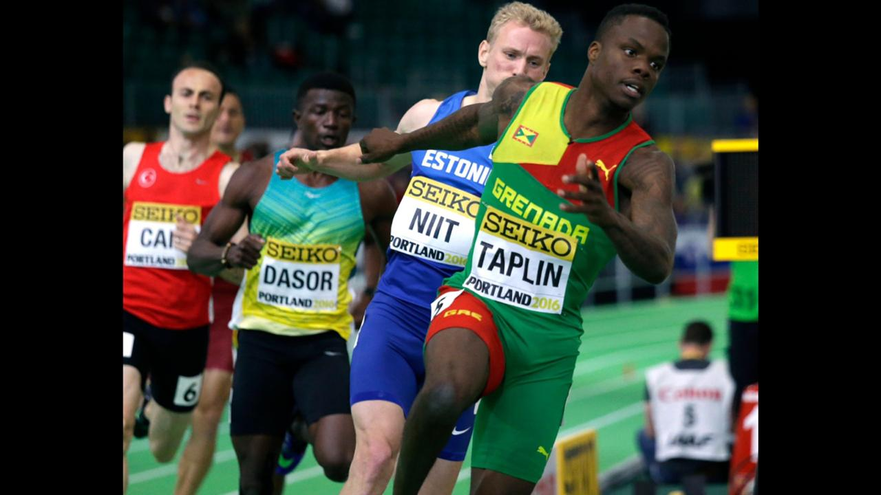 In this Friday, March 18, 2016 file photo, Grenada's Bralon Taplin, foreground, competes in a heat of the men's 400-meter sprint during the World Indoor Athletics Championships, in Portland, Ore. (AP Photo/Elaine Thompson, File)