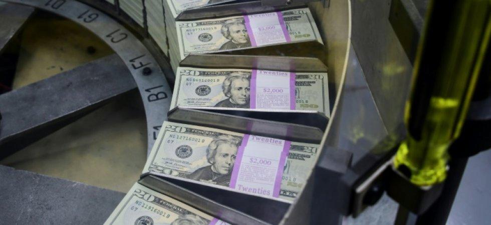 Des paquets de billets de 20 dollars fraîchement imprimés au Bureau of Engraving and Printing du Trésor américain à Washington, DC, le 20 juillet 2018. ©Eva HAMBACH, AFP