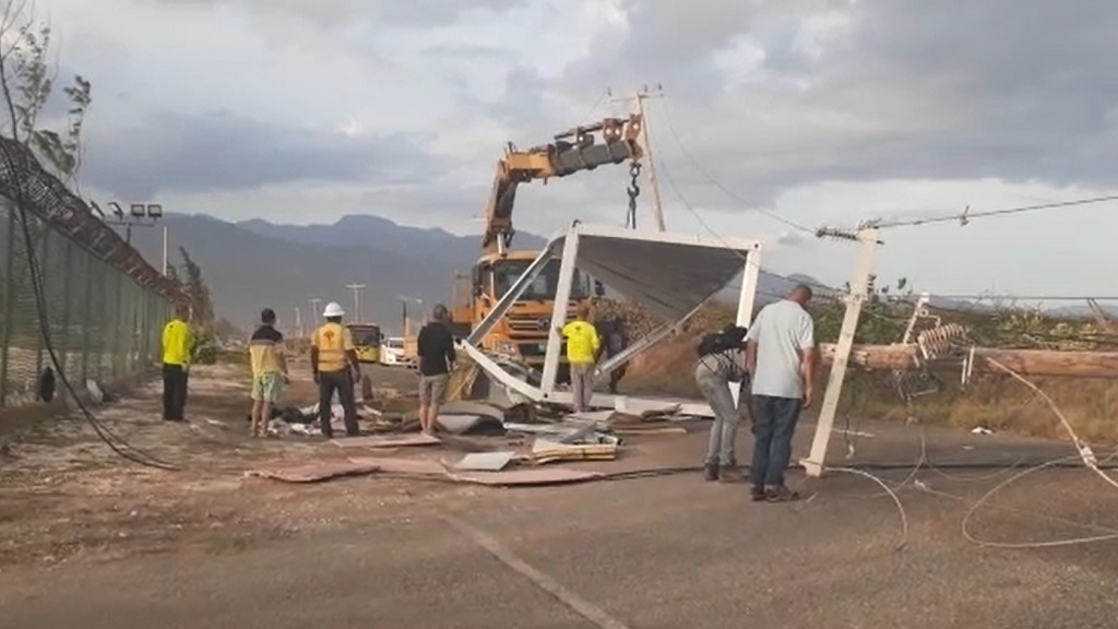 A screengrab from a video of the scene where a truck tore down light wires and poles along the Palisadoes road in Eastern Kingston on Wednesday.