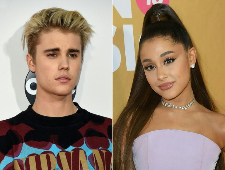 "Justin Bieber et Ariana Grande, réunis pour un duo, ""Stuck with You"" Valerie MACON, Angela Weiss AFP/Archives"