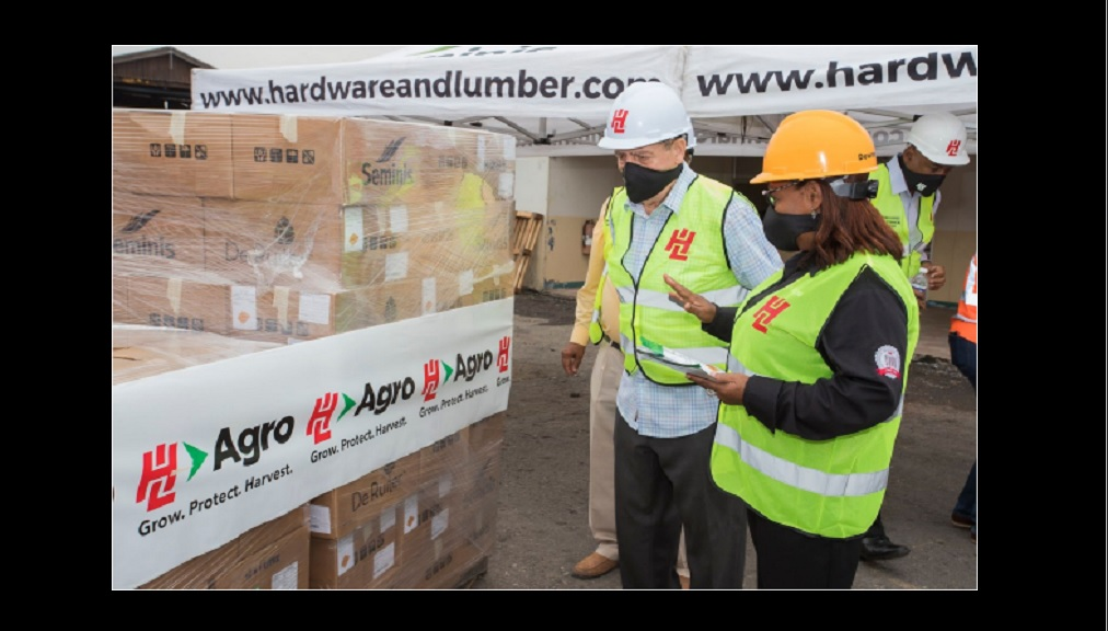 Olive Downer Walsh, Deputy CEO, Hardware & Lumber (right) and Audley Shaw, Minister of Industry, Commerce, Agriculture and Fisheries inspect seeds that are part of H&L Agro's donation of $2 million in agricultural supplies that will be distributed to farmers by the ministry.