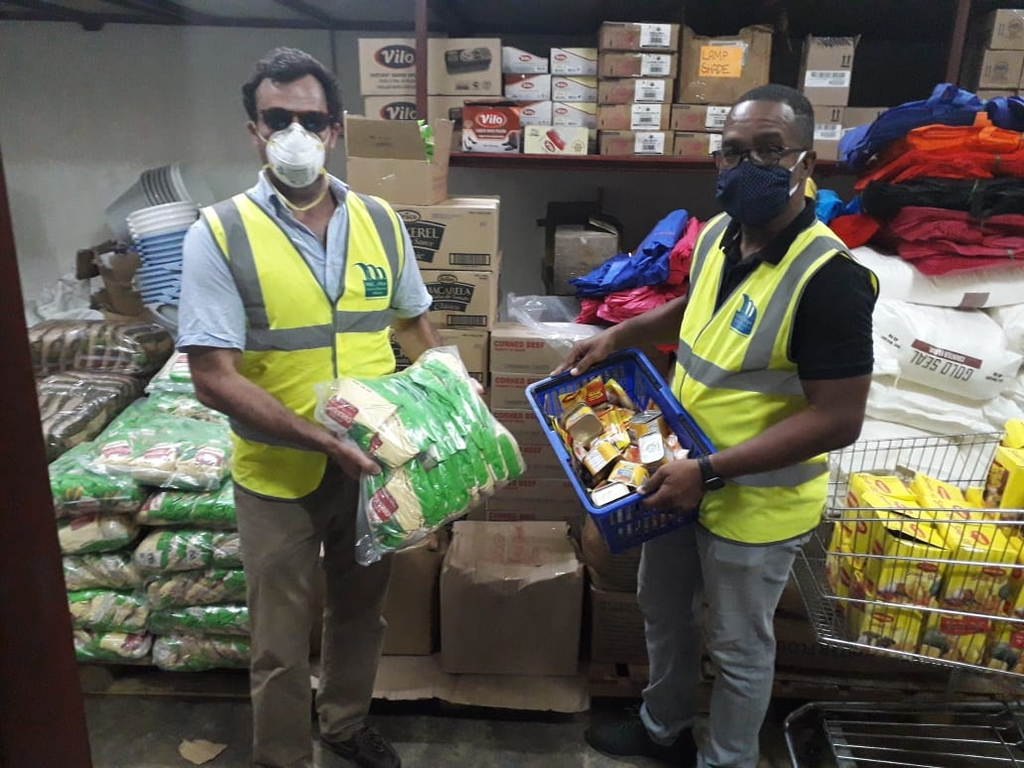Country Manager for Miya Jamaica, Alvaro Ramalho (Left) and NWC-Miya team member